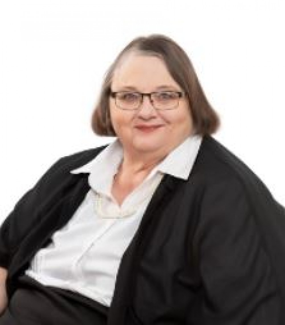 Ms. Nita Schmidlin